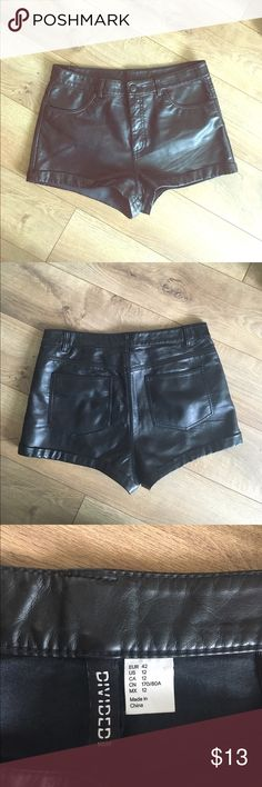 Black leather high waisted shorts! Faux black leather high waisted shorts. Perfect edgy piece to add to any outfit! Worn twice. Divided Shorts