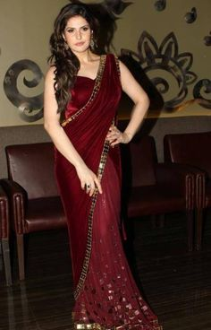 Zarine khan in maroon saree with metal gold Saris, Bollywood Saree, Bollywood Fashion, Bollywood Actress, Bollywood Cinema, Bollywood Wedding, Wedding Sarees, Indian Dresses, Indian Outfits