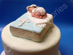 Baby Laying on A book /Baby Shower/First Communion/Christening/Edible Cake Topper made with BLUE Vanilla Fondant Boy or Girl
