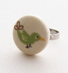 Fabric Covered Button Ring Kit. Shop also offers kits to make button covered hair bands/clips. Cute craft project!
