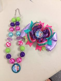 Frozen bow and necklace set on Etsy, $25.00