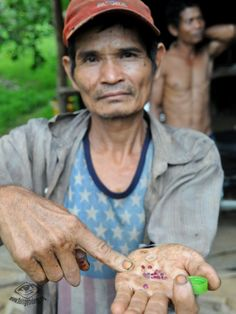 """The last ruby miners of Thailand"""", a Cashew nut plantation worker present us the small rubies he found that day in the area."""