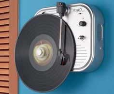 Wall Mounted Turn Table  Now you can listen to your records like never before with this wall mounted turn table. Perfect for compact rooms, this vertical record player is battery powered and has a speaker on-board so it can be used in practically any area of your home.  $50.97