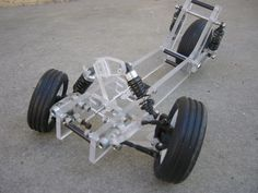 Good example of tilting suspension (Brian: Change mounting points to be horizontal not vertical, could you have car wheels on a tilting motorcycle? You'd need to steer the front wheels and lean! Would that work? Buggy, E Quad, E Mobility, Reverse Trike, Drift Trike, Suspension Design, 3rd Wheel, Pedal Cars, Car Wheels