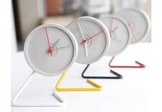 Twistick Table Clock - The twisted stand plays with tunes of time in concrete.
