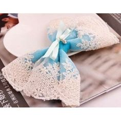 Stunning handmade teal oversized lace hair bow with clip closure. Features blue hand tied bow in the centre and small hanging gem. Lace Hair, Hair Bows, Lolita Fashion, Teal, Blue, Kawaii, Centre, Handmade, Closure