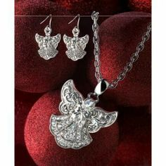 """Angels sparkle and shine in this elegantly fun jewelry set. Like high fashion straight from the heavens, your angels will make your style sing!   Weight: 0.1 lb.  Pendant: 2 1/4""""; chain: 20"""" long; each earring is 1 1/4"""" long.  Iron, alloy zinc and rhinestones."""