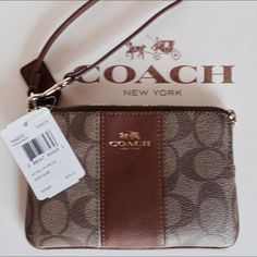 NWT Coach Khaki Signature Wristlet New with tags-Small khaki/brown small PVC signature wristlet trimmed in saddle leather with gold hardware.  Inside lining matches the outside stripe down the middle and has one pocket. F 64233. No trades. Coach Bags