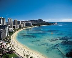 Hawaii - This pic is on the beach in Honalulu. I went with my grandparents when I was 10. We stayed in the small pink hotel in the lower part of this pic. I want to go back someday.