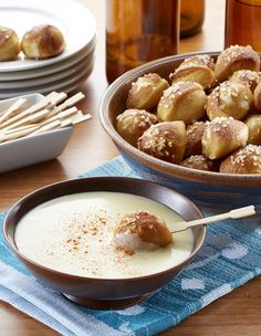 Chewy pretzel bites, dipped in garlicky cheese sauce are an irresistable gameday or holiday appetizer. The best part? Frozen bread dough makes these cheesy snacks simple!