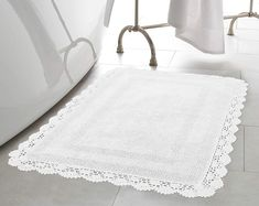 Classically chic, Laura Ashley Crochet Bath Rug Collection features natural cotton rugs in an assortment of rich, saturated colors. Durable cut-and-loop fibers, woven with a lovely crochet border, are reversible for long-lasting use. Laura Ashley Bathroom, Laura Ashley Home, Karim Rashid, Bathroom Rugs, Bath Rugs, Bathroom Furniture, Home Depot, Shower Curtain Hooks, Cotton Crochet