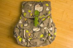 """50% off sale until December 19th!  Discount will automatically be applied to your shopping cart.  These always sell out extremely fast!  Get one before they're gone!  Cute canvas Totoro backpack! Size is approximately 13""""x15"""".  We now have 2 colors - GREEN & RUST."""