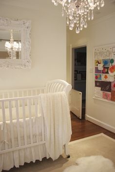 Love the mirror above the crib reflecting the chandelier. Must do!