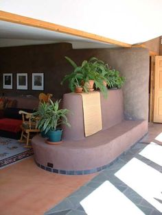 Love the cob bench as a divider. Maybe in the front of the living room to help divide the space? From http://www.touchtheearthranch.com