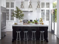 Three small rooms were combined and a conservatory skylight was added to create a big, white, sunny kitchen. Fulk anchored the space with a black island and unified finishes in gleaming metal. Black Kitchens, Home Kitchens, Dream Kitchens, Beautiful Kitchens, Beautiful Homes, House Beautiful, New Kitchen, Kitchen Dining, Kitchen Ideas
