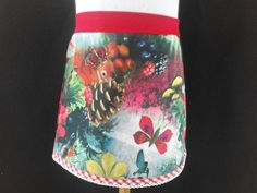 Kiekeboefjes.  Zelfgemaakte originele kinderkleding. Jurkjes en rokjes met roezels en kant. Leuke gekleurde stofjes. Creatieve geboorteschilderijen en cadeautjes, slabbetje en speenkoorden.