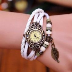Stylish cord style watch with beads and popper closure.  Features leaf charm.