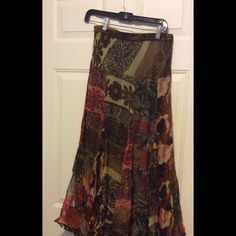 Anu Skirt Multi-color skirt with multiple floral  designs.  Long, lined with a dark skirt underneath, light weight, 100% rayon and stretches (elastic) around the waist. Anu Skirts Maxi