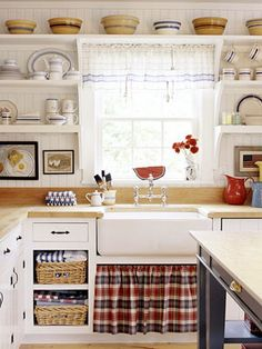 Great clean white kitchen with blue and red accents!