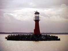 Pervalka Lighthouse or Lighthouse of Horses, the Curonian Lagoon, Lithuania by shintapostcard, via Flickr by Divonsir Borges