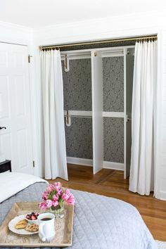 Replacing Bi-fold Closet Doors with Curtains: Our Closet Makeover (Driven by Decor) Curtains For Closet Doors, Folding Closet Doors, Mirror Closet Doors, Closet Curtain Door, Hanging Closet, Replacing Closet Doors, Ideas For Closet Doors, Build In Closet, Diy Closet Ideas