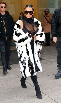 Out in New York City wearing a Miu Miu fur coat, Gaultier turtleneck, Yeezy leggings and boots, and Céline sunglasses.
