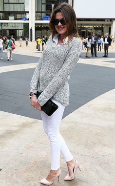 Emily from New York Fashion Week Spring 2015 Street Style  The fashionista breaks out a snug sweater over her white jeans and nude pumps.