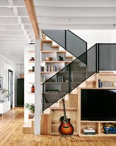 Stair Step Bookcase small reach in closet with door panels dark toned wooden floors of