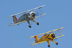 The Real Aeroplane Company's Bucker Bu 133 Jungmeisters G-BUTX and G-AXMT/U-99 in formation at the 2010 Flying Legends airshow