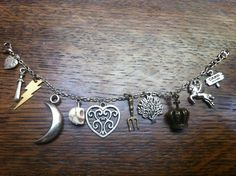 Percy Jackson charm bracelet. FRIENDS! YOU NOW KNOW WHAT'S AT THE TOP OF MY WISHLIST!!!