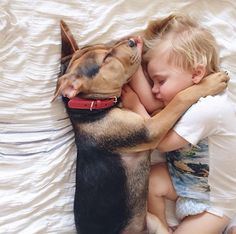 When babies and puppies cuddle. These two are the cutest little nuggets I've ever seen! They nap together every day.