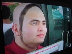 Hairstyle? Long sideburns? Fashion statement? What the hell is this? - I would pay to see this in person.