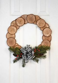 Get Busy Making These Rustic Christmas Wood Crafts for Your Home : Wood Slice Wreathcountryliving How To Make Christmas Tree, Wooden Christmas Trees, Noel Christmas, Rustic Christmas, Simple Christmas, Christmas Wreaths, Beautiful Christmas, Christmas Wood Decorations, Crochet Christmas