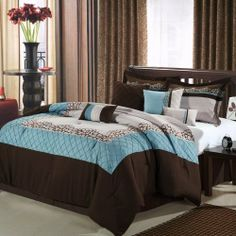 """Mustang Brown, Blue, Beige 8 Piece Queen Comforter Bed In A Bag Set by Chic Home. $84.99. This bedding ensemble transforms the bedroom into a restful escape with the captivating bedding ensemble. Elegant embroidered motifs, scrolls and delicate pin tucks are set on a beige background with blue and brown borders. One Queen Comforter 90 x 90One Queen bedskirt - 14"""" dropTwo Standard pillow shams 20"""" x 26"""" with a 2"""" flangeFour Decorative pillows 18 x 18 (2), 20 x 20..."""