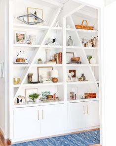 "Take a crash course in ""Shelf Styling 101"" via @em_henderson + shop this space via link in profile. #shelfie #styling #midcenturylamp #rug #rejuvespotted"