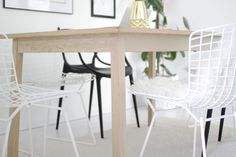 White Bertoia Wire Side chairs, black Kartell Master's and white-washed oak modern oak table in our dining room.