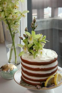 A moist butter cake with less butter and less sugar, filled with no butter lemon curd, and iced with yogurt-cream cheese. Adorned simply with pretty orchids, and suddenly you have a low fat, delicious celebration cake.