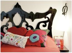Plywood Cutout  It doesn't take a large amount of skills (just a scroll saw), to cut plywood or masonite into any shape imaginable. To create an ultra-cool headboard, trace your design and cut it out, then sand, paint or stain, and attach to your wall. Done.
