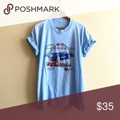 "Periwinkle Corvette Tee Random ""Corvetter for Christopher"" light blue tee. Super soft and oversized. Would be great cut as a crop top!  BRAND: Screen Stars MATERIAL: 50/50 YEAR/ERA: 80s LABEL SIZE: XXL BEST FIT: L  MEASUREMENTS: Chest 22.5 inches Length 28.5 inches   Trades  Modeling  Check out my closet for more vintage tees! Vintage Tops Tees - Short Sleeve"