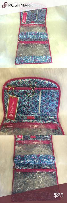 Lilly Pulitzer hanging travel bag Lilly Pulitzer for Target My fans hanging travel bag. New with tags. Features clear section compartments with zipper closure. Lilly Pulitzer for Target Makeup Brushes & Tools