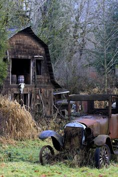 Barn and derelict vehicles in the Foothills of the North Cascade Mountains, WA State