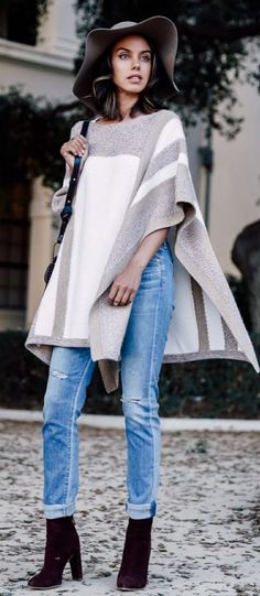 what to wear with a poncho hat bag boots ripped jeans