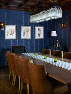 This dining room is inside the Los Angeles home of Modern Family star Jesse Tyler-Ferguson and his husband, Justin Mikita. The midnight blue wall covering with brass stud detailing had my heart from hello, and the statement glass chandelier captured the light, beautifully. What an inspiring dining room, see more in my book Dream Decor.