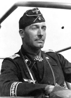 Major von Wietersheim in black Panzer crew jacket and field cap with pink Waffenfarbe and Totenkopf collar patches. Note the 'GD' shoulder insignia and copper-plate script version of the cuff band.
