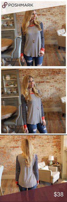 "Oatmeal and navy striped top with orange trim Modeling size small.  95% rayon 5% spandex.  Bust laying flat: S 18"" M 19"" L 20"" Length S 27"" M 28"" L 29"". Add to bundle to save when purchasing.  SM13040929.T71219 Tops"