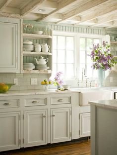 White cabinets, beadboard walls, exposed ceiling