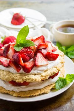 Decadent, delicious, and piled high with coconut whipped cream! Oh, and this vegan strawberry shortcake has a twist: the strawberries are soaked in a zippy maple ginger marinade.#veganfood #veganrecipes #vegetarian #vegetariarecipes #dessert #dessertrecipes #strawberry #strawberriesandcream #strawberries