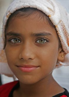 Smiles, a universal language.   Girl at the temple.  Amritsar by dennis_read2000, via Flickr