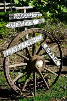Crystal and Crates Vintage Rentals has wagon wheels / http://www.deerpearlflowers.com/rustic-country-wagon-wheel-wedding-ideas/