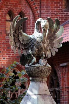 A large bronze bird adorns the top of the well at Malbork Castle.photo by Morgan Thomas Pelican Tattoo, Malbork Castle, Dragons, Baltic Cruise, Christian Artwork, Gothic Architecture, Sacred Art, Garden Ornaments, Medieval